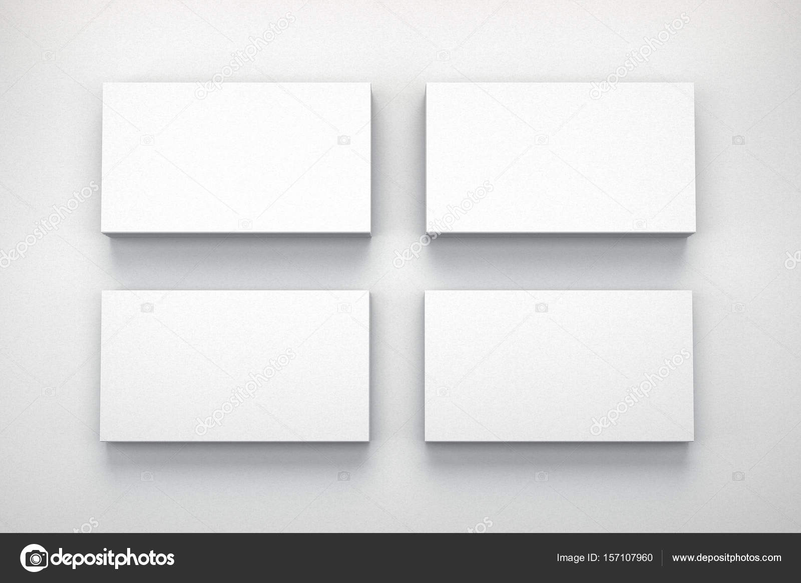 Mockup of four business cards on white textured paper studio. High ...