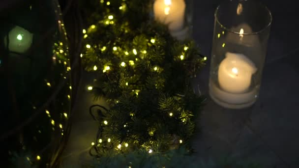 Christmas and New Year fir and the illuminations of garlands and candles