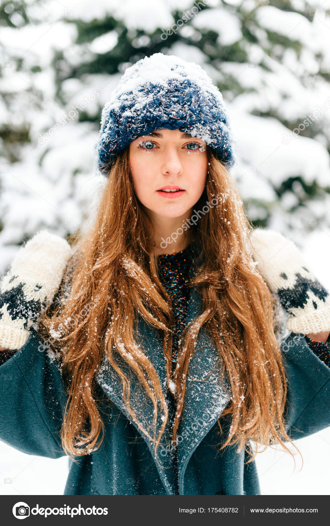 Snow queen young girl with amazing beautiful face blue fantsastic eyes and long perfect hair closeup