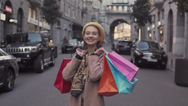 Female shopper with colorful shopping packages. Black Friday sales
