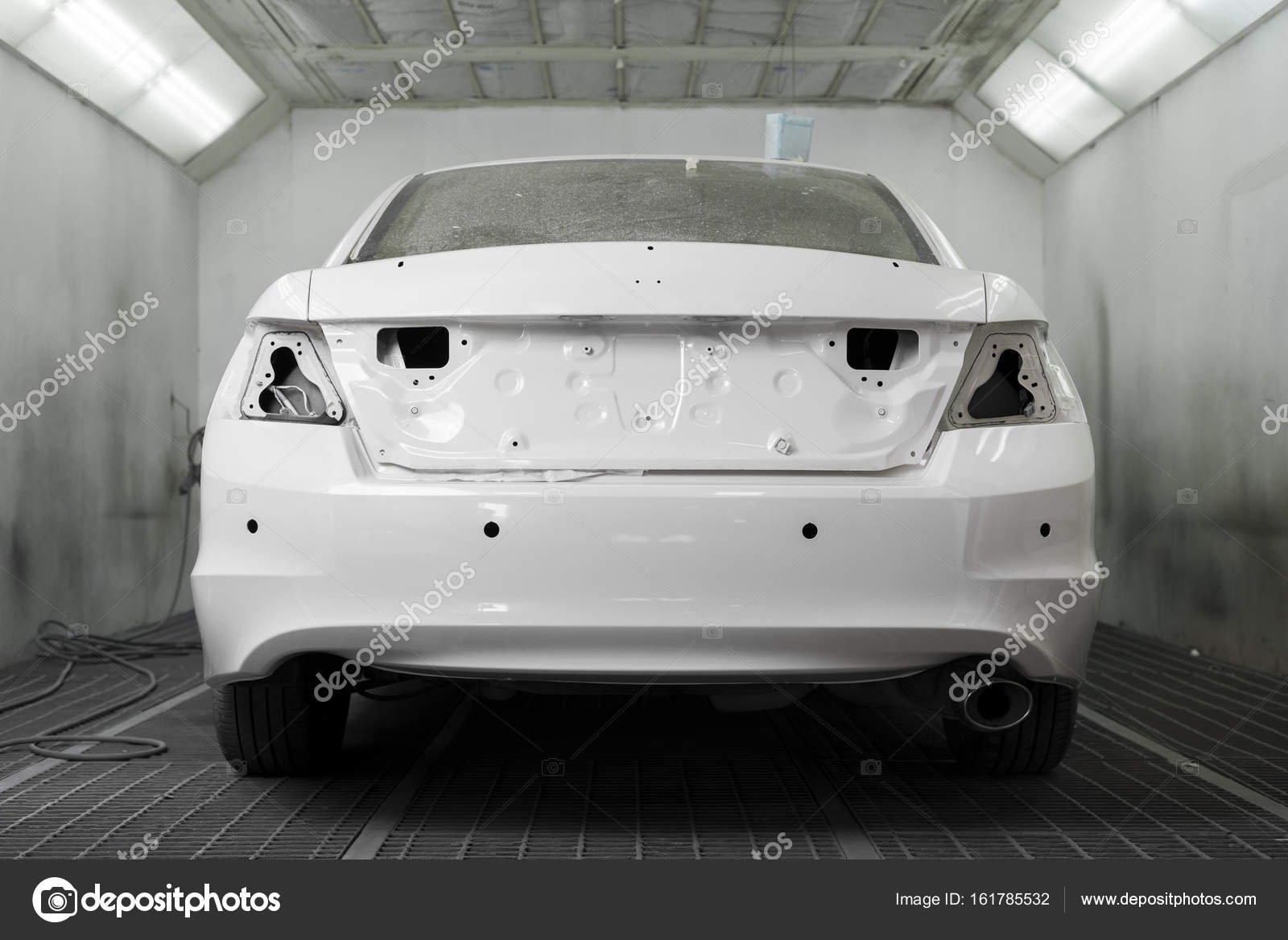 Auto Body Repair Back Of White Car In Paint Booth Stock