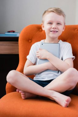 Young boy playing games on digital tablet computer
