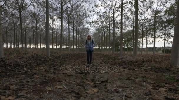 Beautiful caucasian woman walking in forest. Adventure, travel, tourism and leisure concept