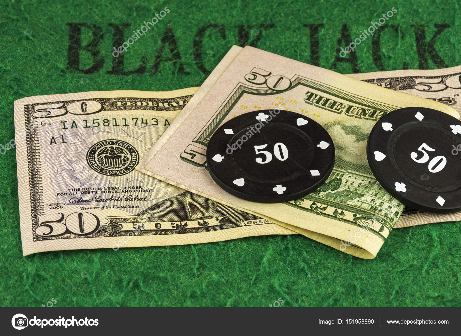 aca99f3953a6 Two black chips lie on two 50 dollar bills — Stock Photo © Grommik ...