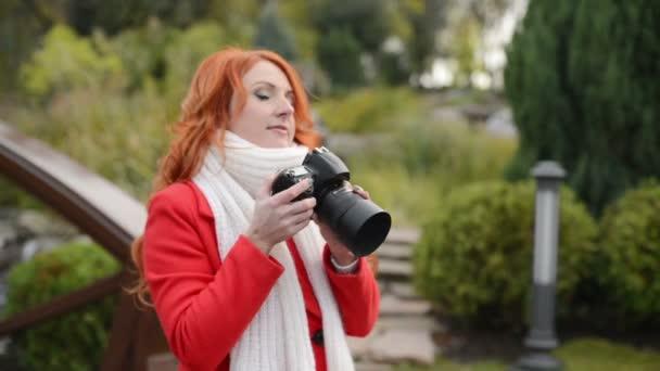 beautiful woman making photo using professional camera