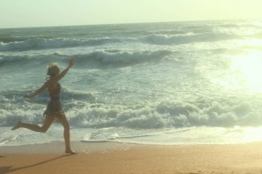 Blurred shot of a girl on the beach.