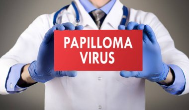 Doctor's hands in blue gloves shows the word papilloma virus. Medical concep