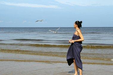 Baltic sea,  woman  feeding white gulls