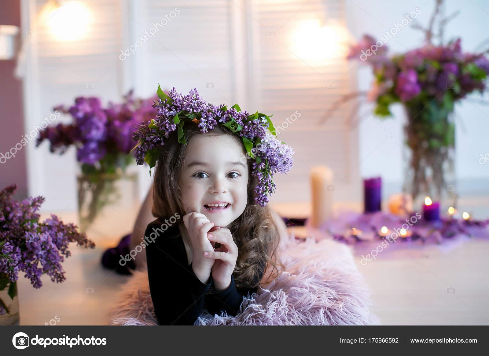 Little Smiling Girl Posing Lying Floor Purple Flowers Bouquets