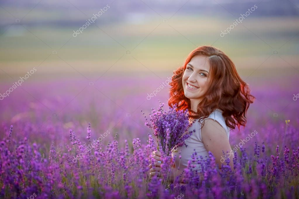 beautiful woman posing on lavender field