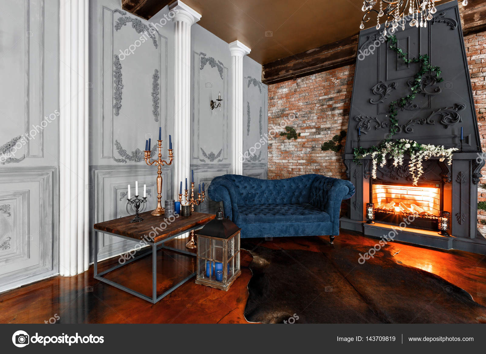 Interior With Fireplace Candles Skin Of Cows Brick Wall Large Window And A Metal Cell Of A