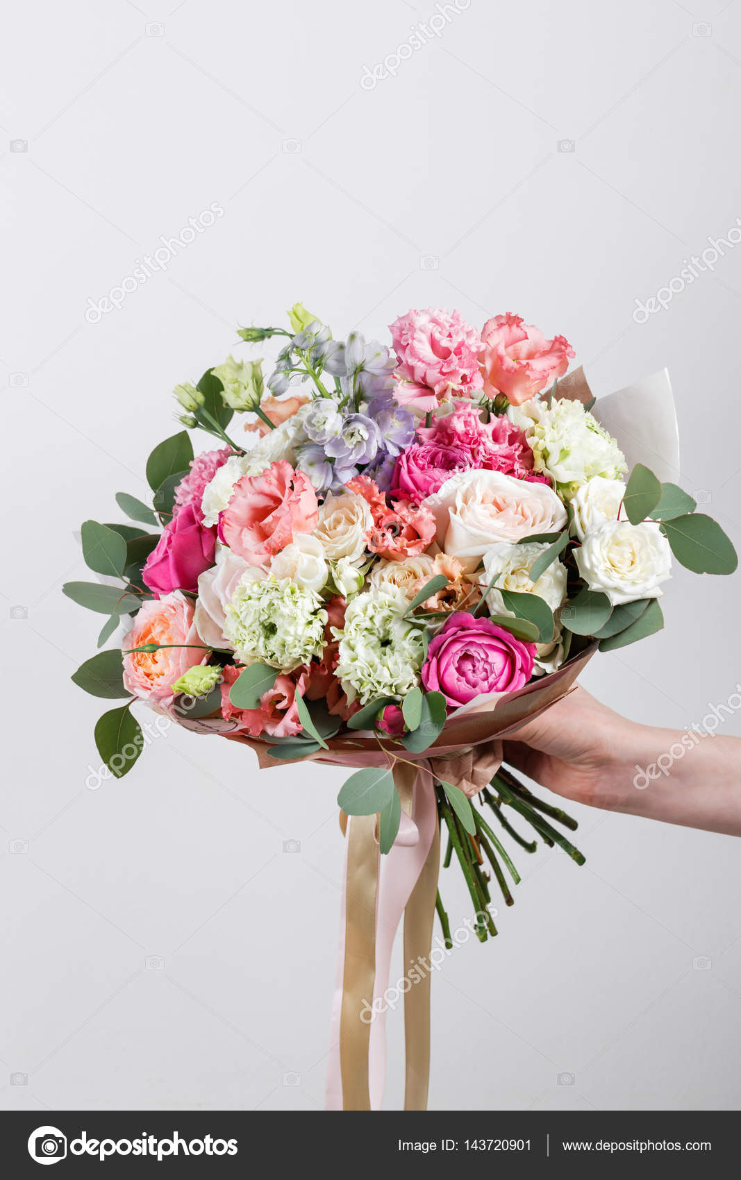 a05676f6 Rich bunch flowers in hand Fresh spring bouquet. Summer Background. — Stock  Photo