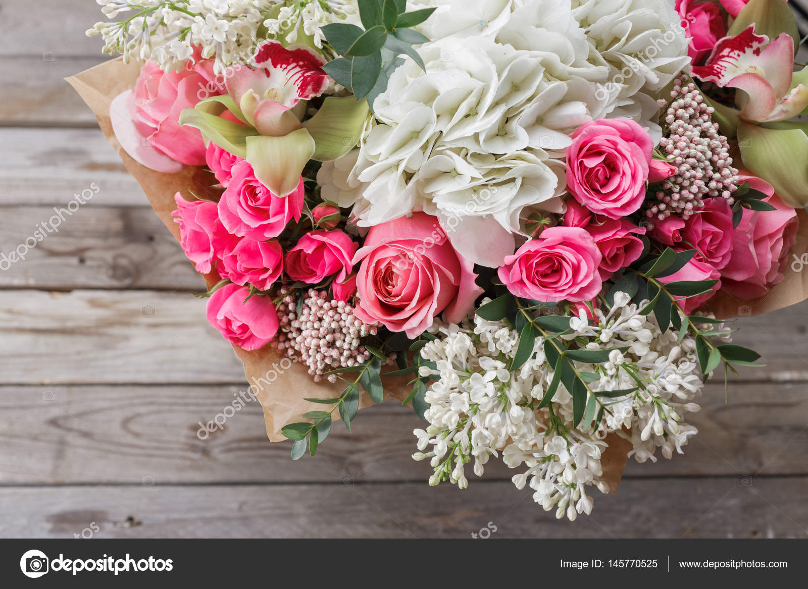 Luxury bouquet of different flowers in glass vase on wooden wall luxury bouquet of different flowers in glass vase on wooden wall copy space stock izmirmasajfo