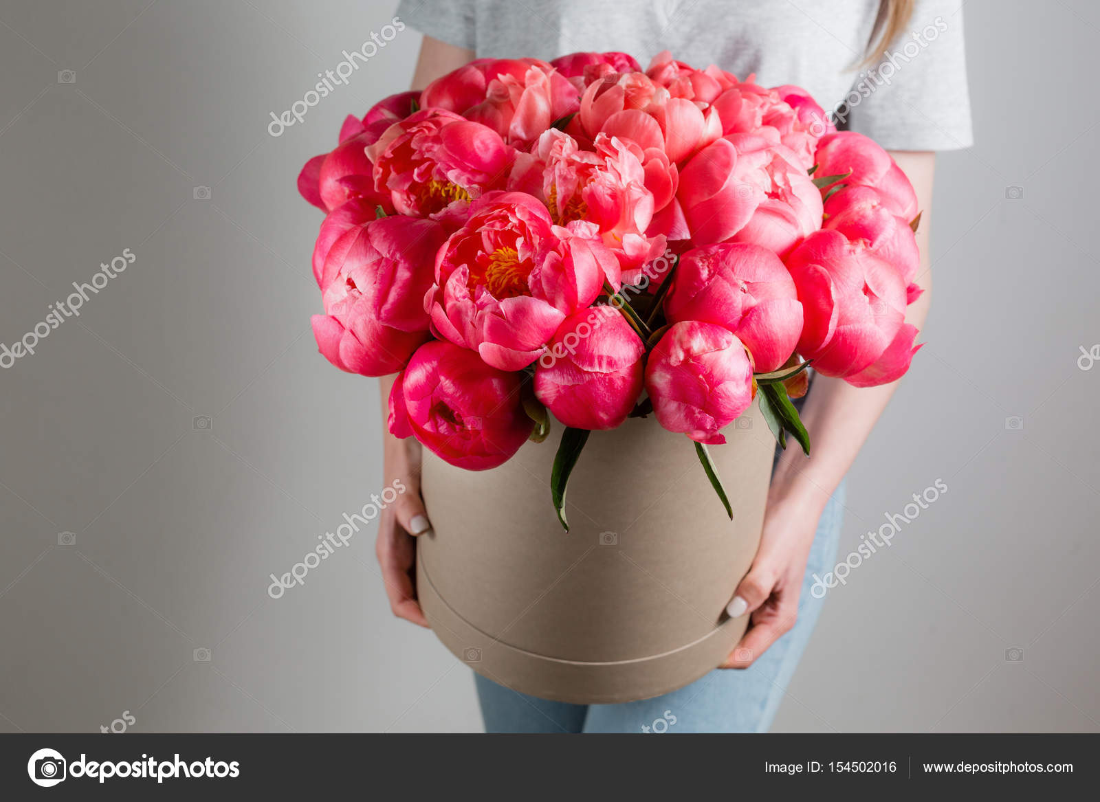 Girl holding beautiful mix coral and pink flower bouquet in round girl holding beautiful mix coral and pink flower bouquet in round box with lid peonies mightylinksfo
