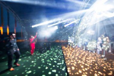 Blurred colorful lights inside music club