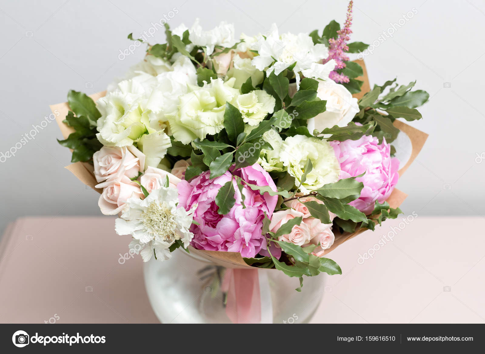 cute light bouquet with pink peonies and mixed flowers on pink ...