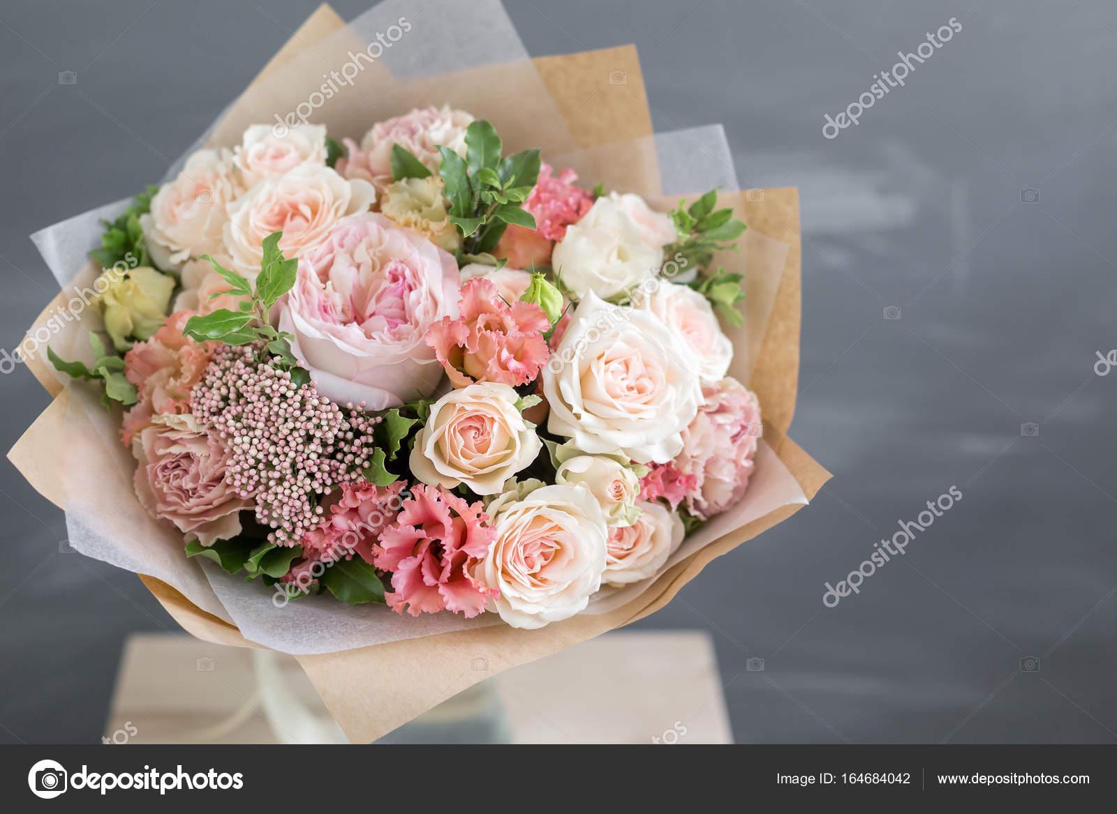 Bouquet in kraft paper a simple bouquet of flowers and greens bouquet in kraft paper a simple bouquet of flowers and greens stock photo izmirmasajfo