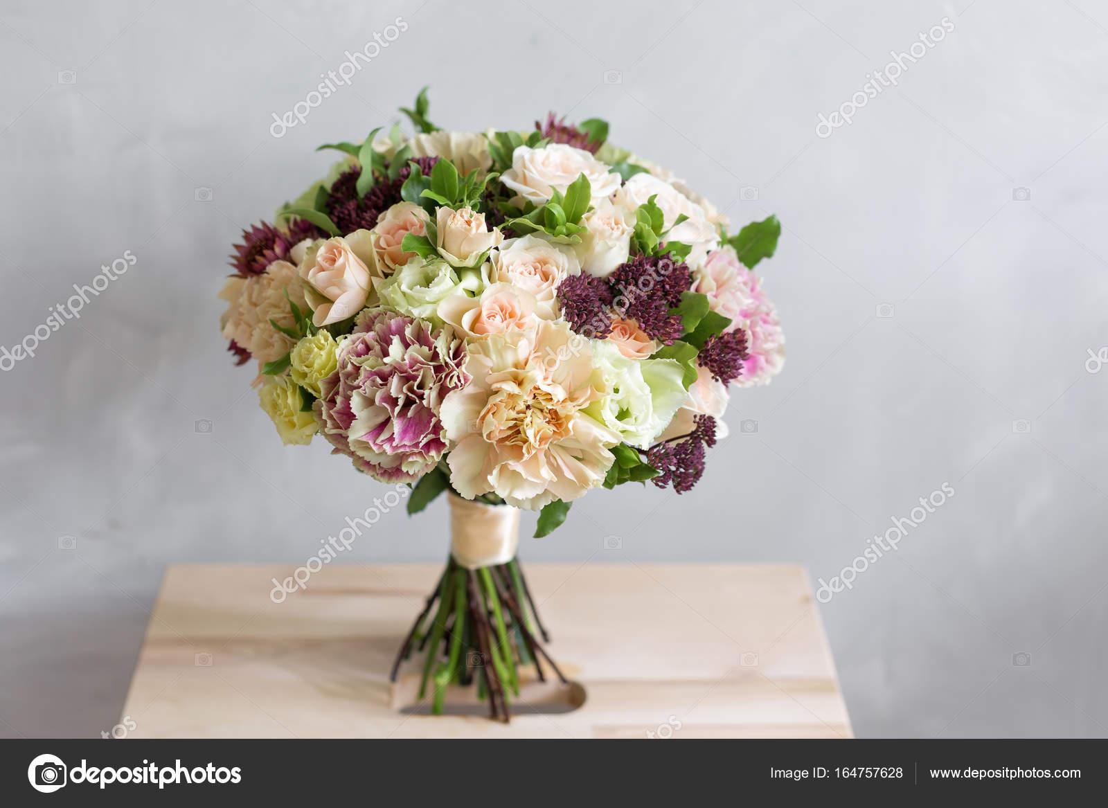 The brides bouquet a simple bouquet of flowers and greens stock the brides bouquet a simple bouquet of flowers and greens stock photo izmirmasajfo