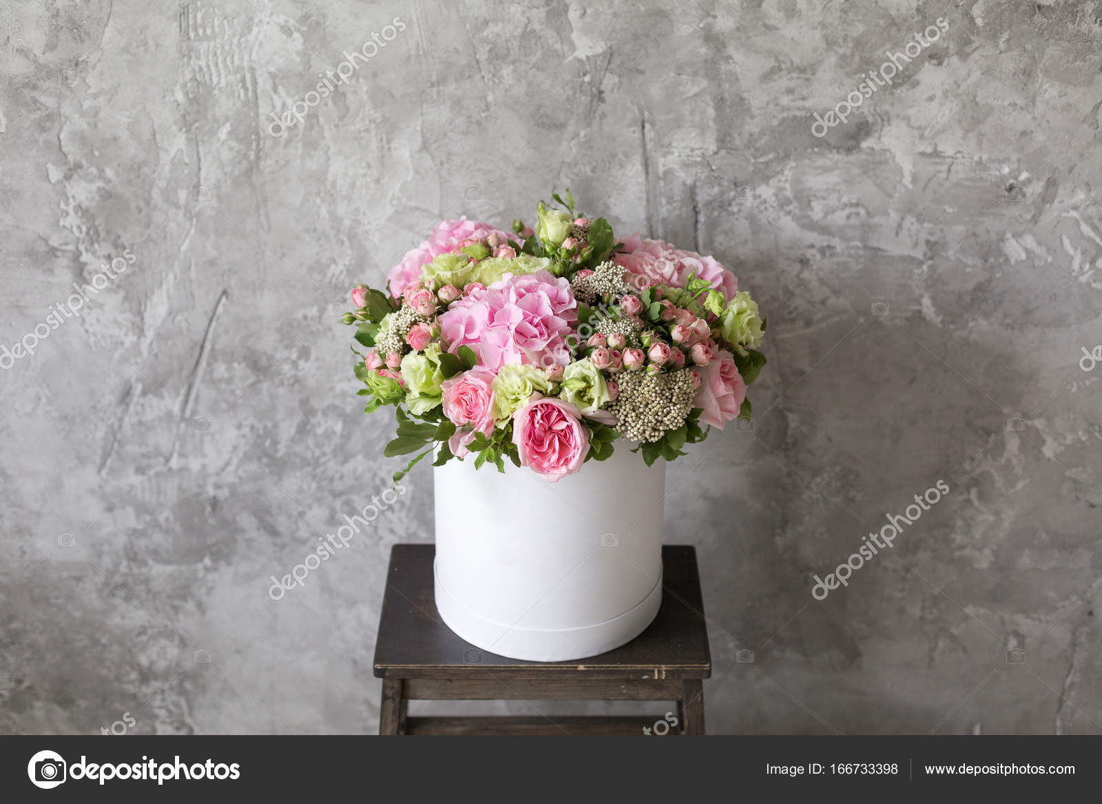Beautiful tender bouquet of flowers in white box on gray ackground beautiful tender bouquet of flowers in white box on gray ackground with space for text assembled a bouquet of professional florists gentle colors photo izmirmasajfo