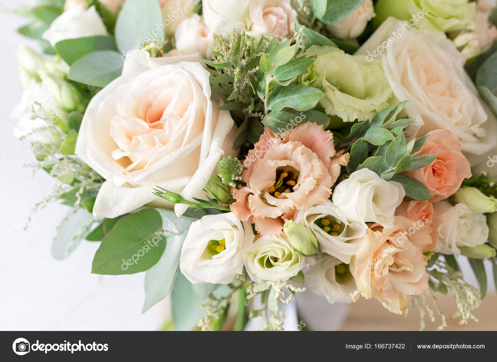 Bridal bouquet a simple bouquet of flowers and greens stock photo bridal bouquet a simple bouquet of flowers and greens stock photo izmirmasajfo