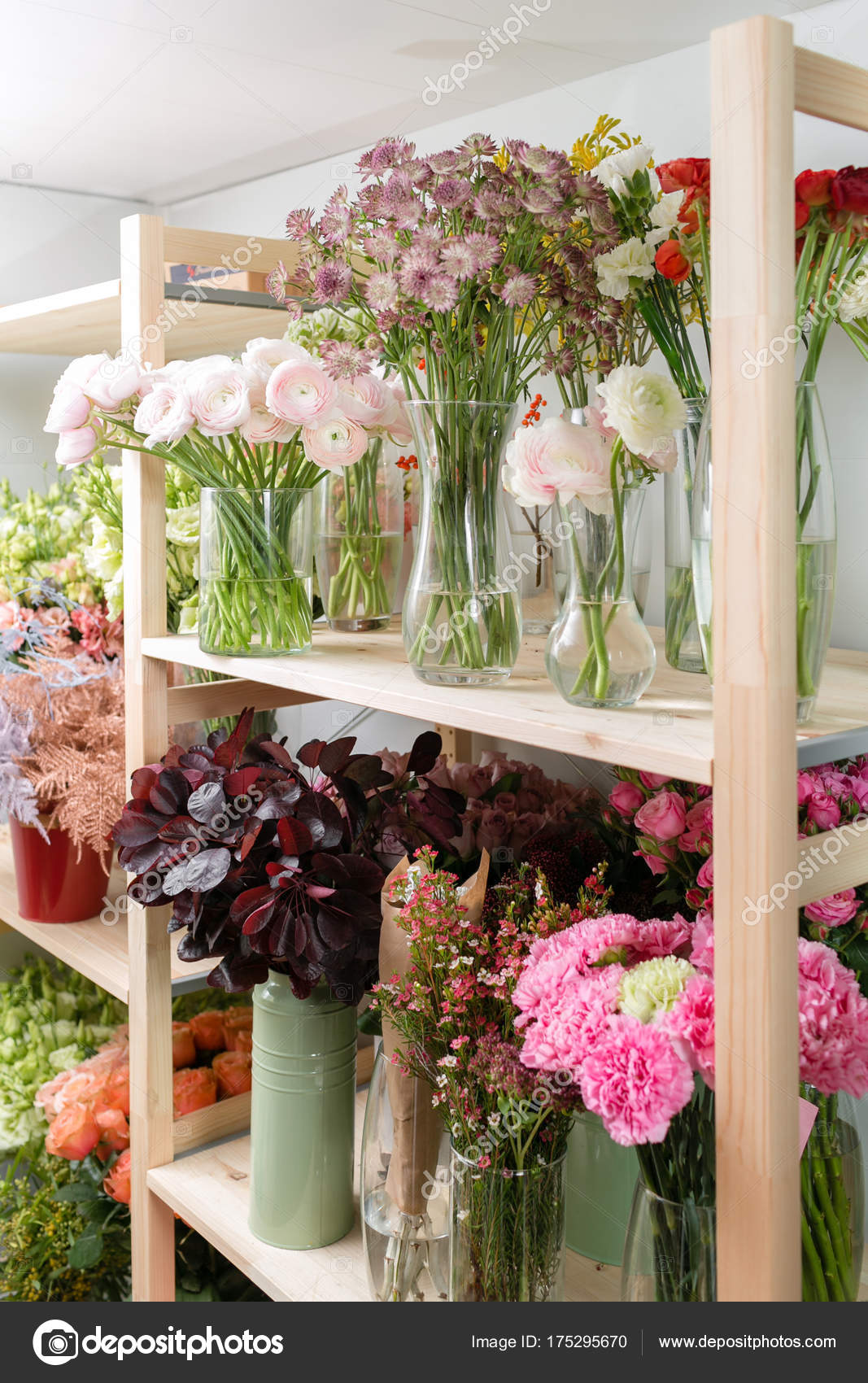 Different Varieties Fresh Spring Flowers In Refrigerator For
