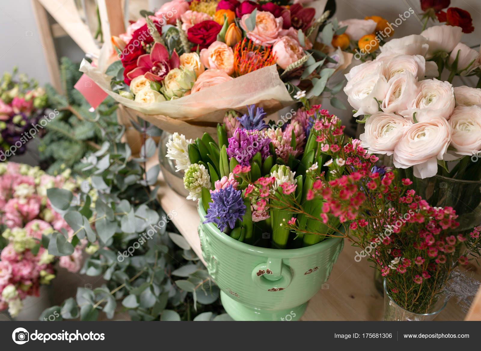 Different varieties fresh spring flowers in refrigerator for different varieties fresh spring flowers in refrigerator for flowers in flower shop bouquets on shelf florist business photo by malkovkosta mightylinksfo