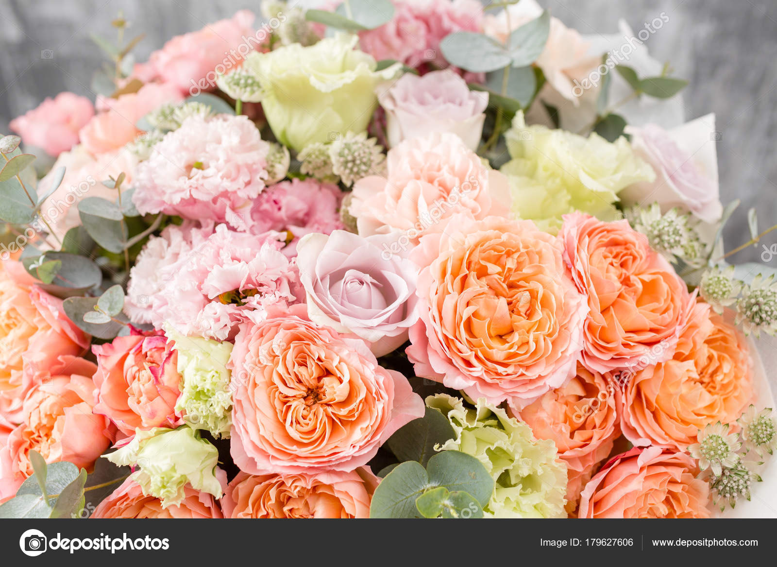 Beautiful Bouquet Of Mixed Flowers In A Vase On Wooden Table The