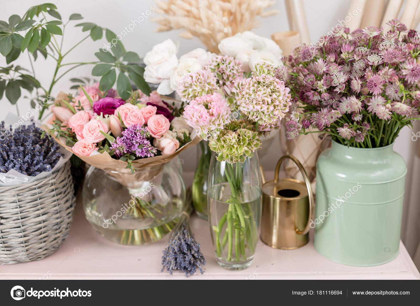 Few of beautiful luxury bouquet mixed flowers on pink table the few of beautiful luxury bouquet mixed flowers on pink table the work of the izmirmasajfo Choice Image