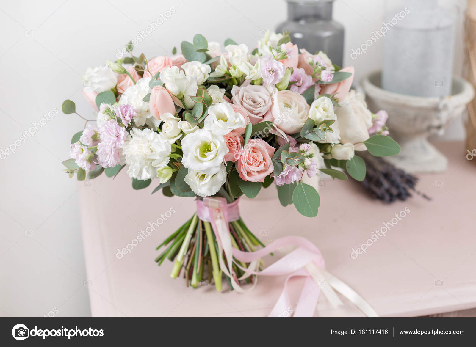 beautiful luxury bouquet of mixed flowers on pink table. the work of ...
