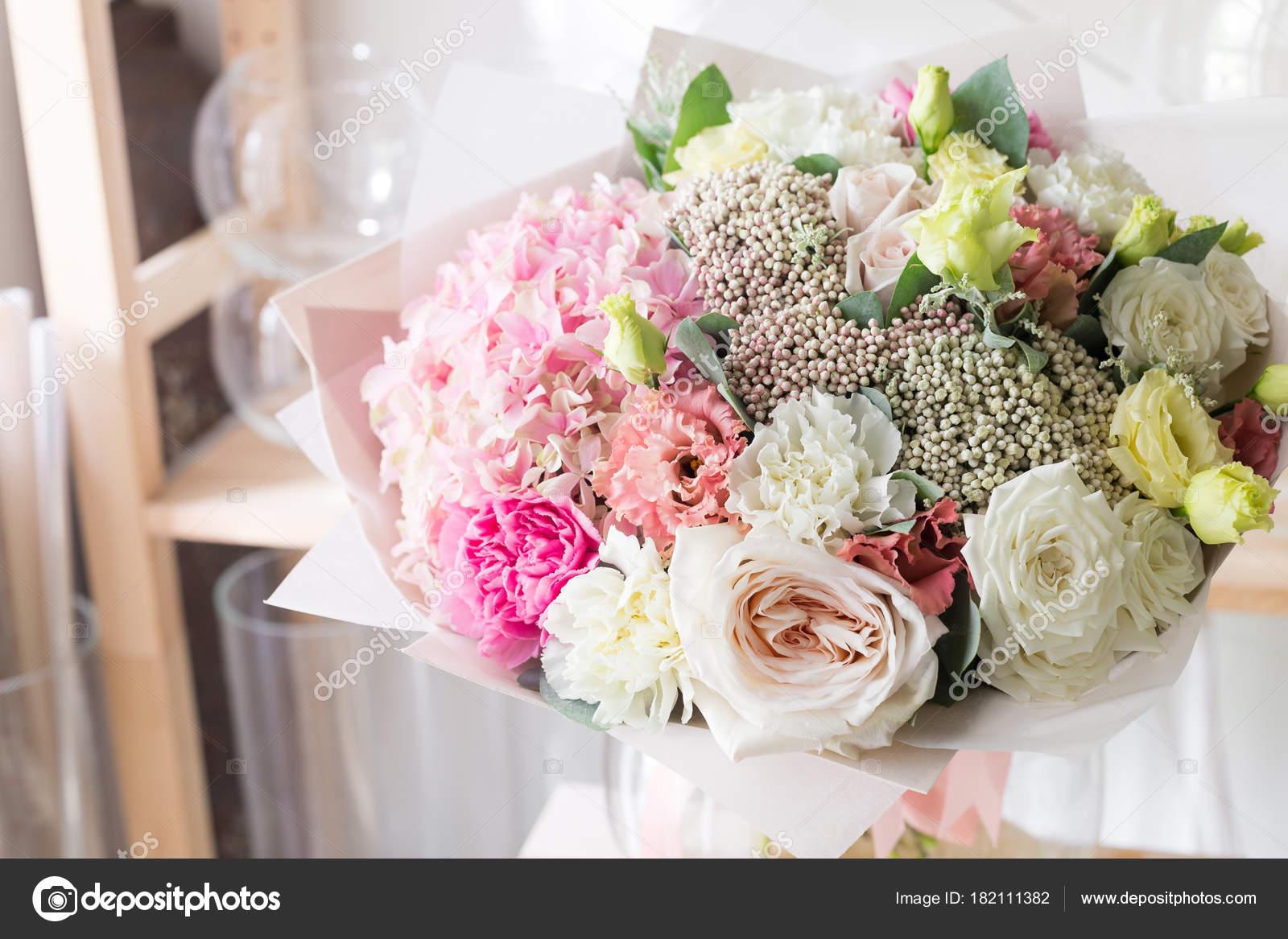 Bouquet in foamiran paper a simple bouquet of flowers and greens bouquet in foamiran paper a simple bouquet of flowers and greens stock photo izmirmasajfo