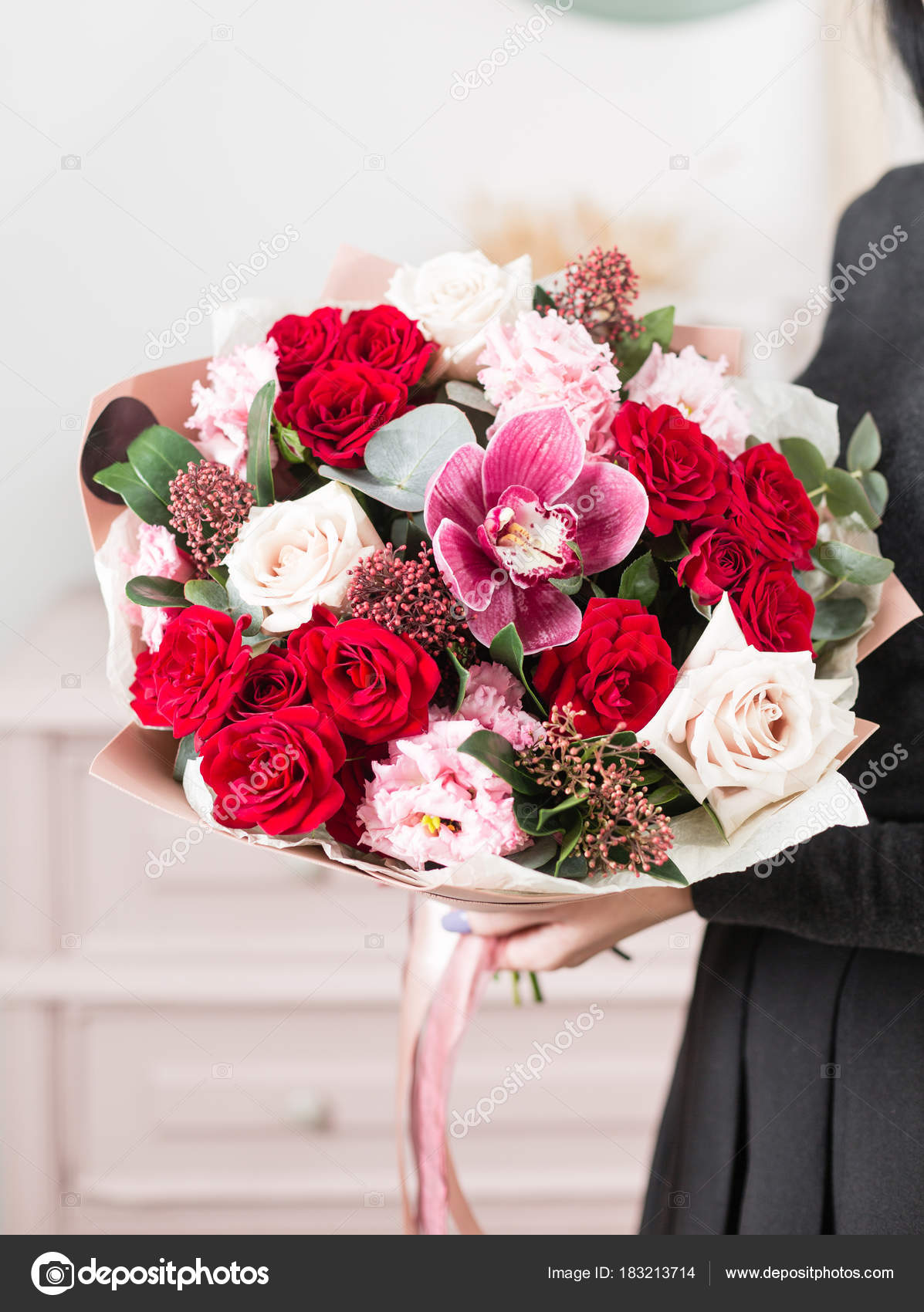 Beautiful luxury bouquet of mixed flowers in woman hand the work of beautiful luxury bouquet of mixed flowers in woman hand the work of the florist at a flower shop cute lovely girl photo by malkovkosta izmirmasajfo