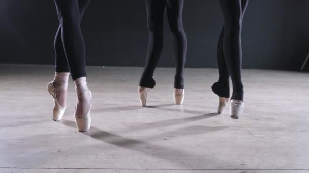Pointe shoes close up. Young ballerina girls. Women at the rehearsal in black bodysuits. Prepare a theatrical performance