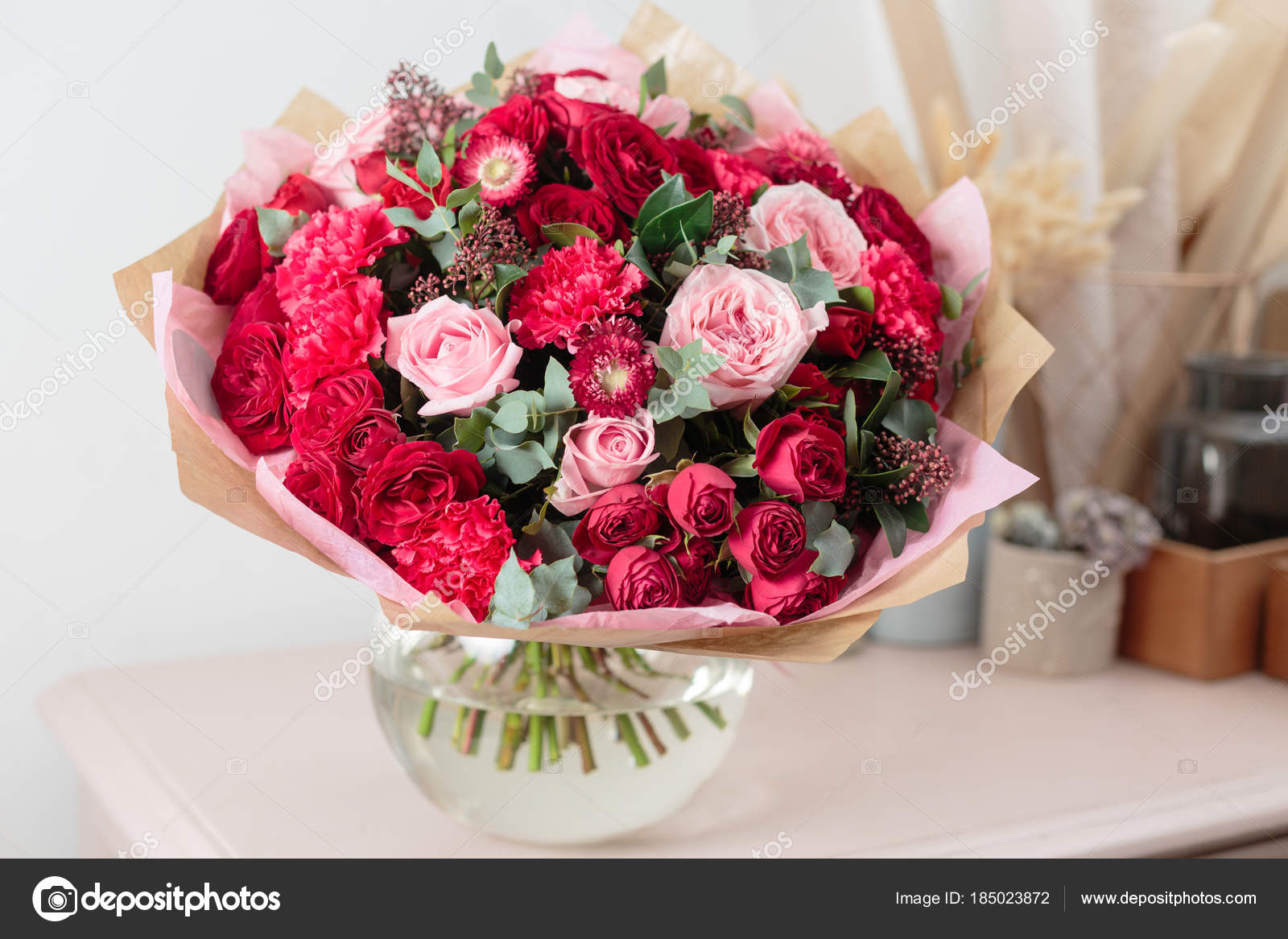 Close up beautiful luxury bouquet of mixed red and pink flowers in close up beautiful luxury bouquet of mixed red and pink flowers in glass vases the work of the florist at a flower shop photo by malkovkosta izmirmasajfo