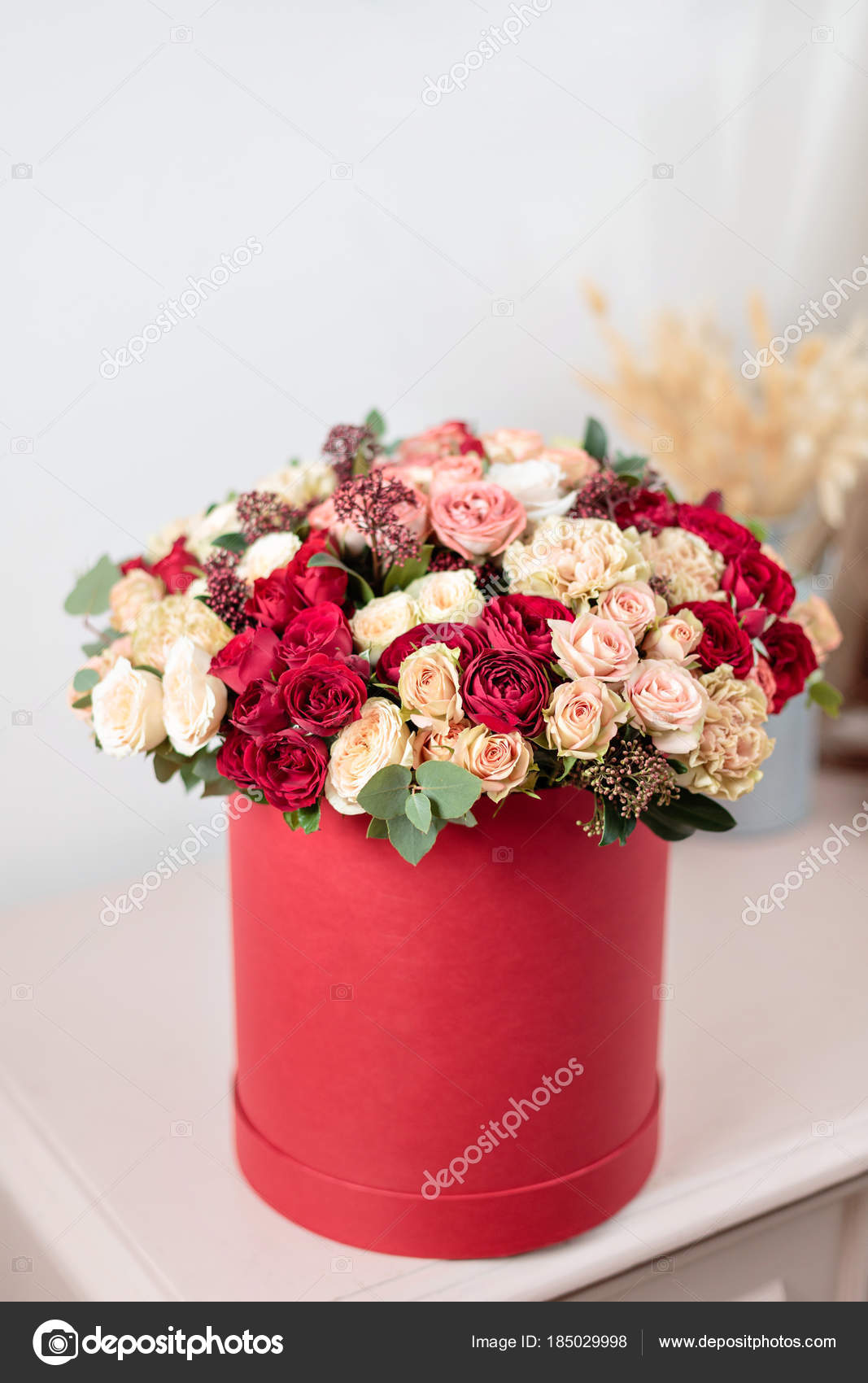 Beautiful luxury bouquet of mixed flowers in red box the work of beautiful luxury bouquet of mixed flowers in red box the work of the florist at izmirmasajfo Choice Image