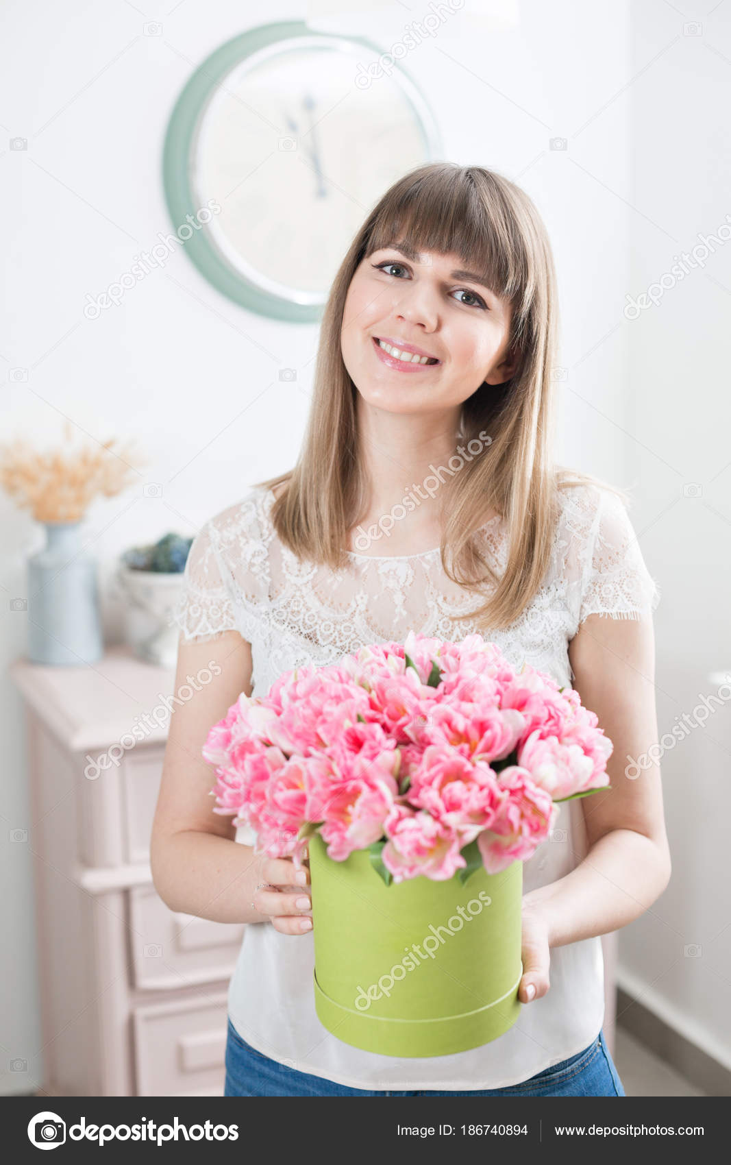Sunny spring morning young happy woman holding a beautiful bunch of young happy woman holding a beautiful bunch of pink tulips in her hands present for a smiles girl flowers bouquet photo by malkovkosta izmirmasajfo Image collections