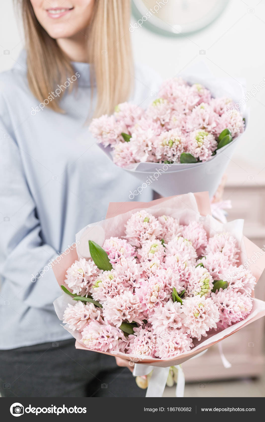 Two flowers bouquet sunny spring morning young happy woman holding young happy woman holding a beautiful bunch of pink hyacinths in her hands present for a smiles girl flowers bouquet photo by malkovkosta izmirmasajfo