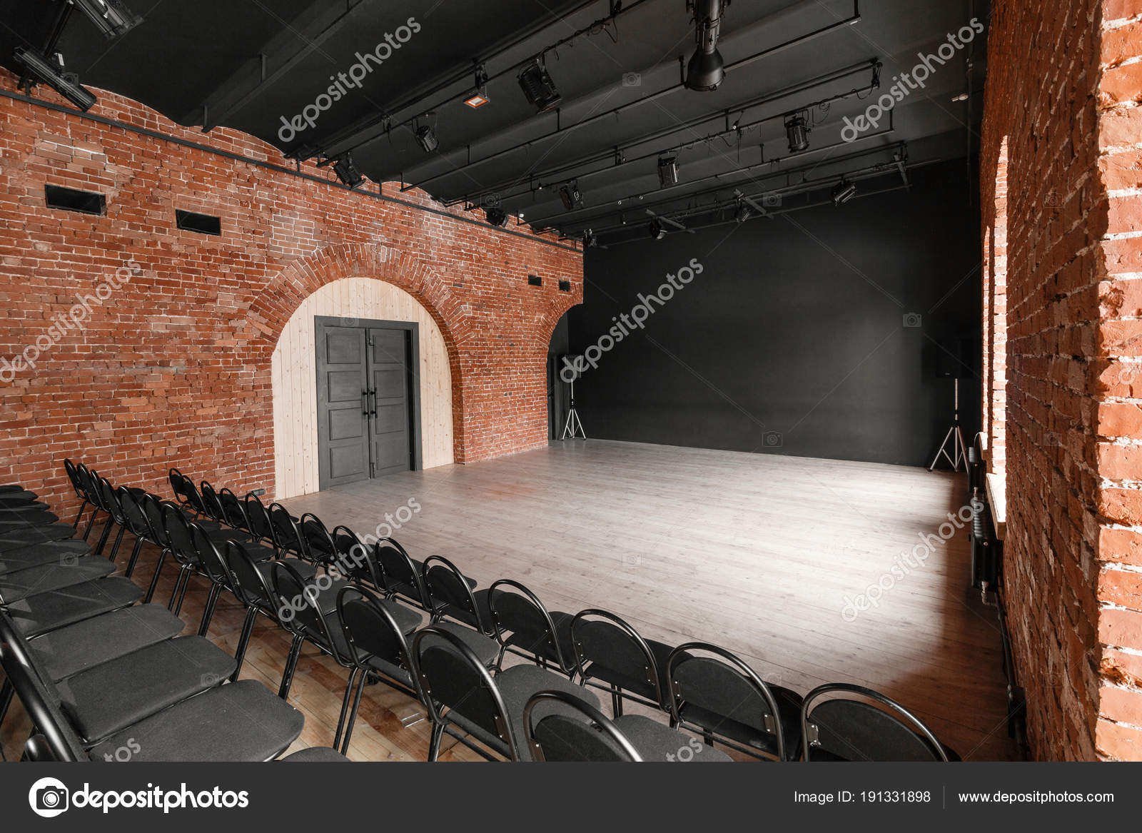 Loft style. Hall with black chairs for webinars and conferences. A huge room with & Loft style. Hall with black chairs for webinars and conferences. A ...