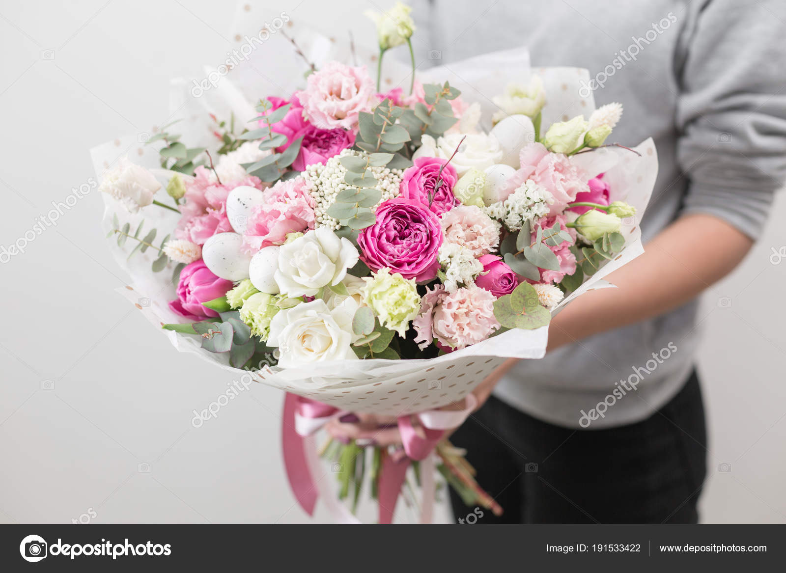 Spring mood. beautiful luxury bouquet of mixed flowers in woman hand ...