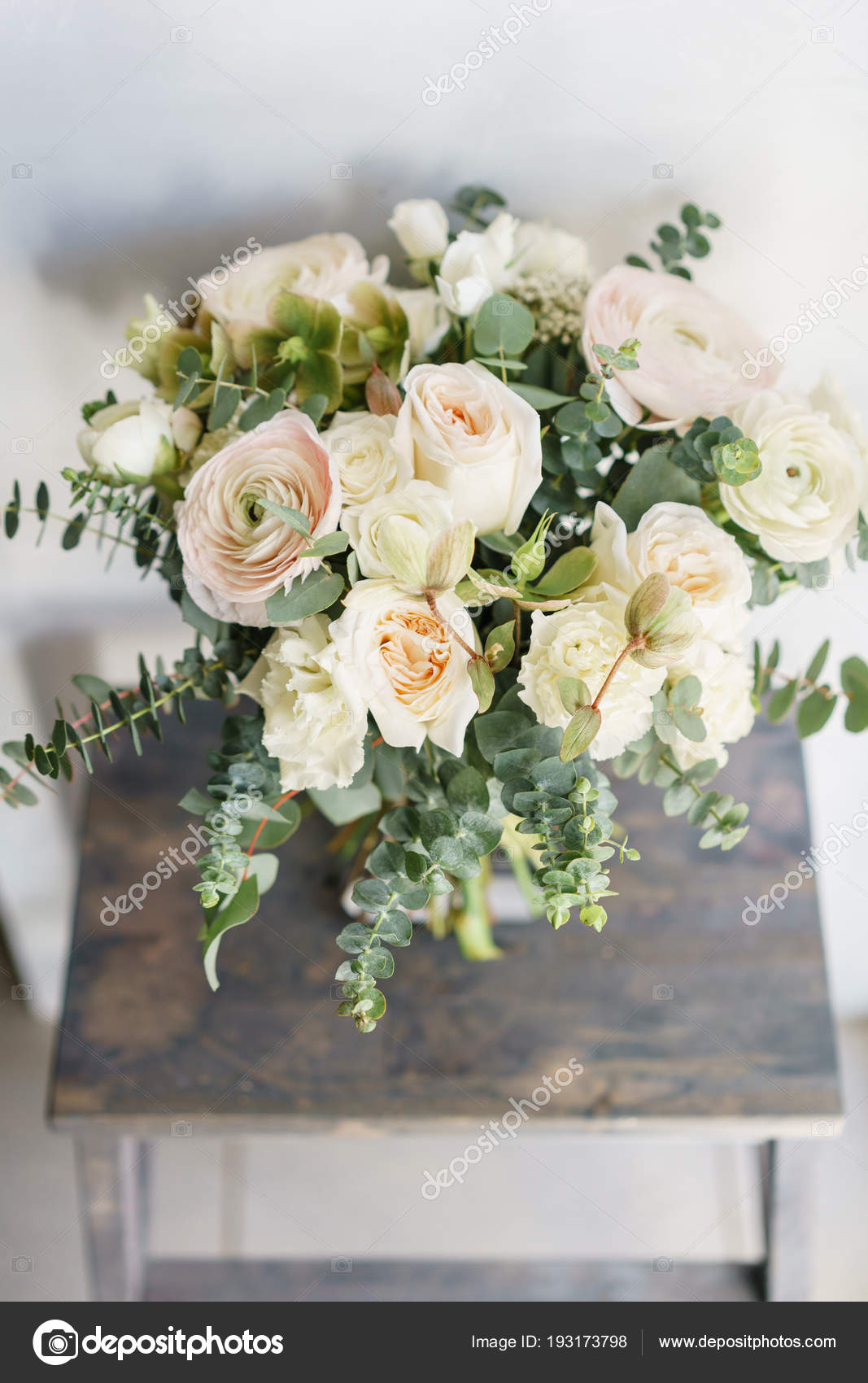 Wedding Bouquet Of White Roses And Buttercup On A Wooden Table Lots