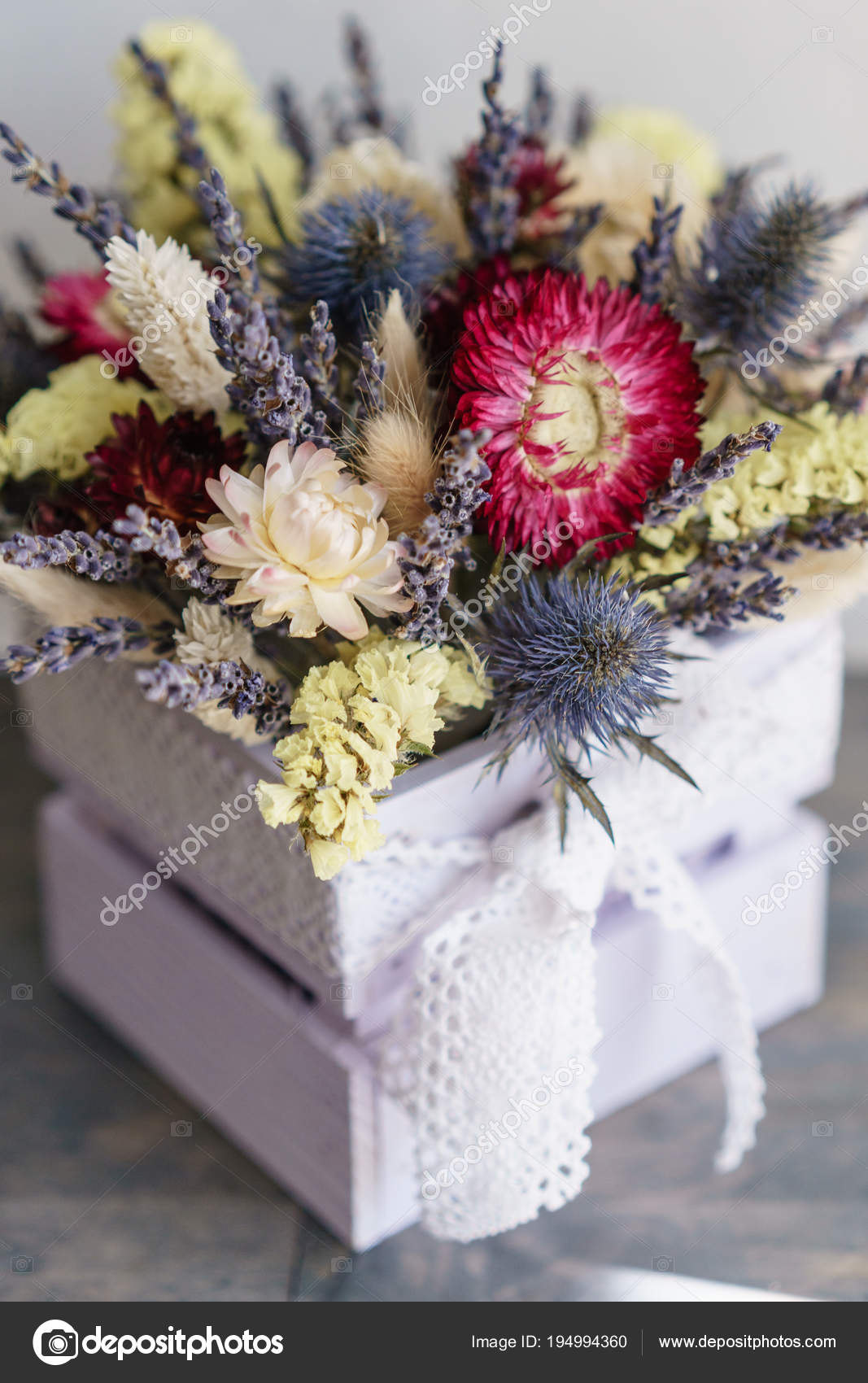Beautiful mini bouquet lavender and dry flowers on table stock beautiful mini bouquet lavender and dry flowers on table izmirmasajfo