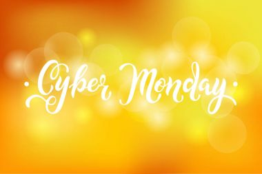Cyber Monday sale quote on yellow abstract bokeh background.