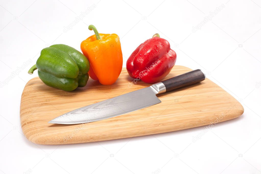 fresh peppers on a wood cutting board