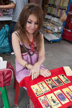 A fortune teller, reads in tarot cards in Chatuchak market, Bang