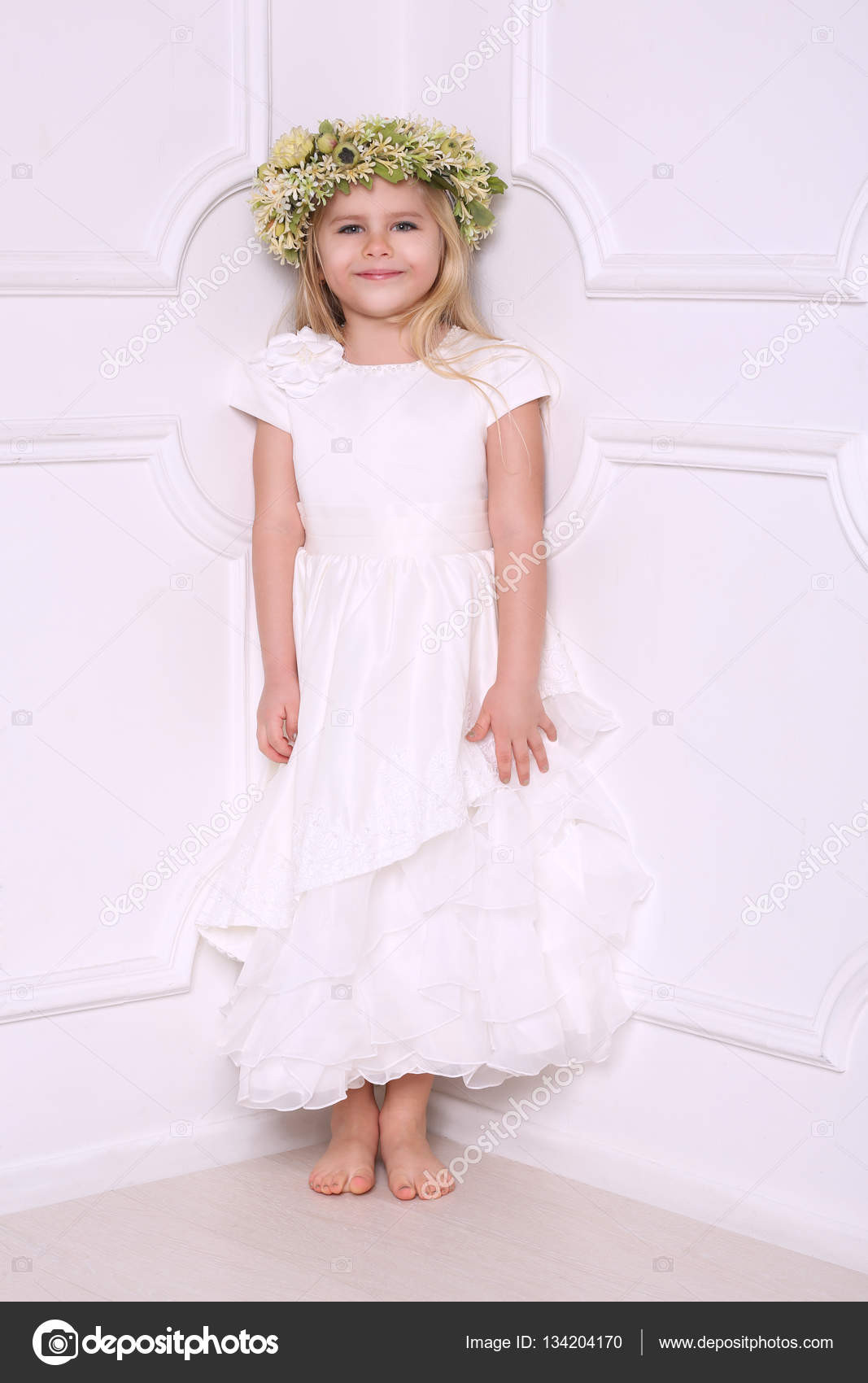 Little girl in dress with head wreath. White background — Stock ...