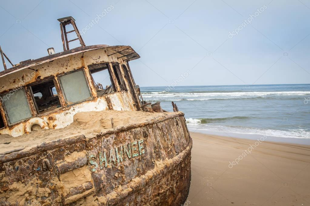 Stranded boat at the coast of the Namibian Desert.