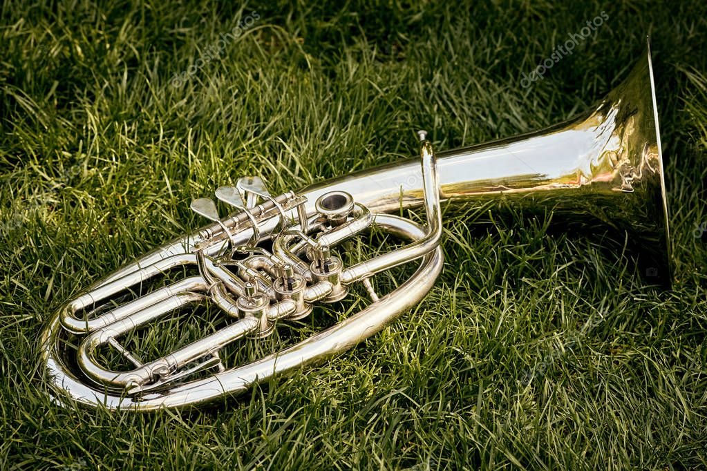 Closeup of a musical wind instrument orchestra of silver trumpet