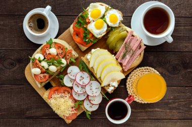 Many kinds of sandwiches, bruschetta, and tea, coffee, fresh juice - for a family breakfast.
