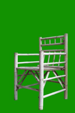Isomatic view of chair made from bamboo on green background.