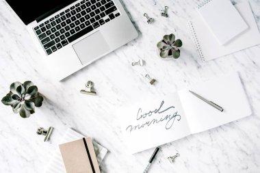 feminine workspace with laptop