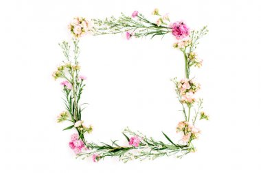 Wreath frame made of pink and beige wildflowers,